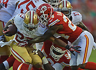 KANSAS CITY, MO - AUGUST 16:  Defensive back Brandon Flowers #24 of the Kansas City Chiefs tackles running back LaMichael James #23 of the San Francisco 49ers for a loss during the first half on August 16, 2013 at Arrowhead Stadium in Kansas City, Missouri.  (Photo by Peter Aiken/Getty Images) *** Local Caption *** Brandon Flowers;LaMichael James