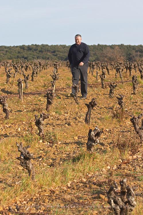 Thierry Rodriguez Domaine Mas Gabinele. Faugeres. Languedoc. Vines trained in Gobelet pruning. Terroir soil. Owner winemaker. In the vineyard. France. Europe.