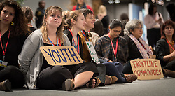 13 December 2019, Madrid, Spain: 'Youth', reads a big sign, as people gather for a sit-in demonstration at COP25, to claim space for a range a groups whose voices are not often listened to in the space of global climate negotiations: youth, women, frontline communities, indigenous communities.
