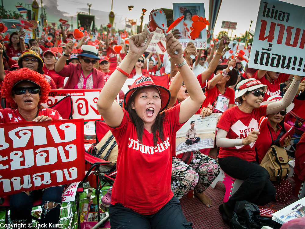 10 MAY 2014 - BANGKOK, THAILAND: A Red Shirt supporter cheers for ousted Prime Minister Yingluck Shinawatra at a rally in Bangkok. Thousands of Thai Red Shirts, members of the United Front for Democracy Against Dictatorship (UDD), members of the ruling Pheu Thai party and supporters of the government of ousted Prime Minister Yingluck Shinawatra are rallying on Aksa Road in the Bangkok suburbs. The government was ousted by a court ruling earlier in the week that deposed Yingluck because the judges said she acted unconstitutionally in a personnel matter early in her administration. Thailand now has no functioning government. Red Shirt leaders said at the rally Saturday that any attempt to impose an unelected government on Thailand could spark a civil war. This is the third consecutive popularly elected UDD supported government ousted by the courts in less than 10 years.    PHOTO BY JACK KURTZ