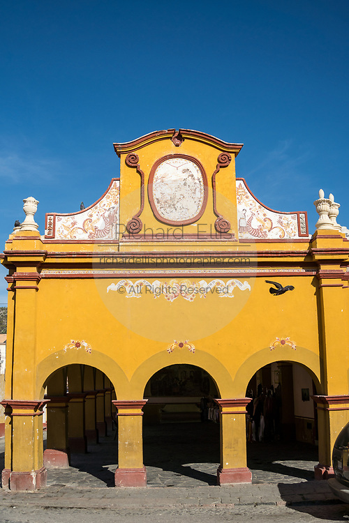 The old town market building in the beautiful colonial village of Bernal, Queretaro, Mexico. Bernal is a quaint colonial town known for the Pena de Bernal, a giant monolith which dominates the tiny village is the third highest on the planet.