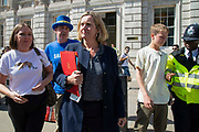 Pro remain campaigner Steve Bray speaks to  Amber Rudd MP, Work and Pensions Secretary as she leaves the Cabinet office in Whitehall, London, United Kingdom on 22nd August 2019.