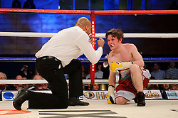 Luke Wilton takes a count in his fight against Lee Haskins at Bantamweight<br /> - Photo mandatory by-line: Rogan Thomson/JMP - Tel: 07966 386802 - 01/03/2014 - SPORT - BOXING - The City Academy, Bristol - James DeGale v Gevorg Khatchikian.