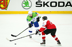 Ken Ograjensek of Slovenia vs Manuel Ganahl of Austria in action during ice hockey match between National Teams of Austria and Slovenia in 5th Round of 2016 IIHF Ice Hockey World Championship Division 1 - Group A, on April 29, 2016 in Spodek Arena, Katowice, Poland. Photo by Marek Piuyzs / Sportida