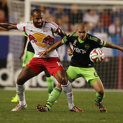Thierry Henry, (left), New York Red Bulls, and Osvaldo Alonso, Seattle Sounders, challenge for the ball during the New York Red Bulls Vs Seattle Sounders, Major League Soccer regular season match at Red Bull Arena, Harrison, New Jersey. USA. 20th September 2014. Photo Tim Clayton