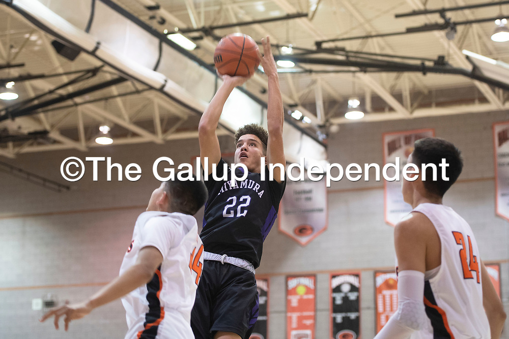 Miyamura Patriot Cael Stewart (22) takes a shot inside the paint against the Gallup Bengals Wednesday night at Gallup High School in Gallup. Gallup took the win 56-51.