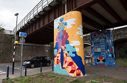 © Licensed to London News Pictures; 18/03/2021; Bristol, UK. A community art scheme, part of Project Sprint, has painted columns underneath the Fox Road railway viaduct in Easton replacing the graffiti that was previously on the columns. Severnside Community Rail Partnership and Network Rail commissioned artist groups and five Bristol artists with connections to the multi-cultural area of Easton to create the new art. It is part of a wider Network Rail initiative known as Project Sprint, which aims to improve graffiti hot spots on the railway across the region. Photo credit: Simon Chapman/LNP.