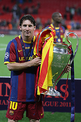 File photo dated 28-05-2011 of Barcelona's Lionel Messi celebrates with the UEFA Champions League trophy
