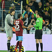 Referee's Cuneyt Cakir show the yellow card to Trabzonspor's goalkeeper Tolga Zengin (L) during their Turkish superleague soccer derby match Fenerbahce between Trabzonspor at the Sukru Saracaoglu stadium in Istanbul Turkey on Sunday 18 December 2011. Photo by TURKPIX