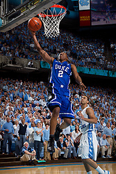 CHAPEL HILL, NC - MARCH 05: Nolan Smith #2 of the Duke Blue Devils scores while playing the North Carolina Tar Heels on March 05, 2011 at the Dean E. Smith Center in Chapel Hill, North Carolina. North Carolina won 67-81. (Photo by Peyton Williams/UNC/Getty Images) *** Local Caption *** Nolan Smith