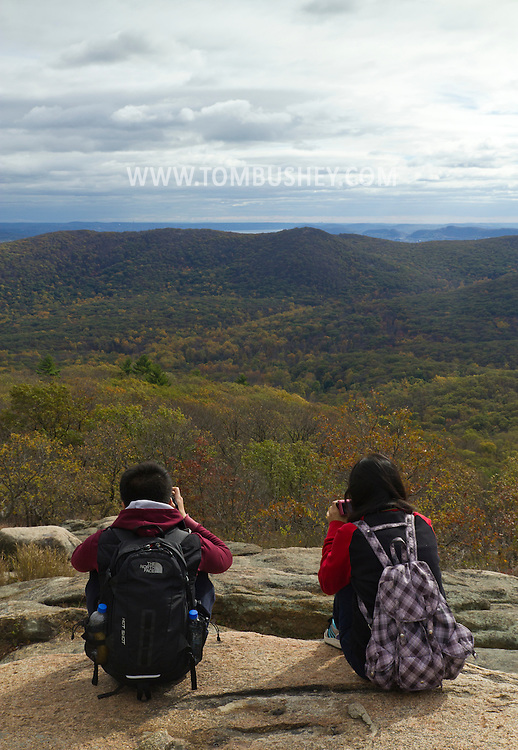 Bear Mountain, New York  - People take photographs of the view from the top of Bear Mountain at Bear Mountain State Park on Oct. 24, 2014.