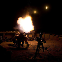 A Ghurka mortar team fires illumination rounds to disrupt enemny activity from Britsih Patrol Base 1, Nahr-e Saraj, Helmand Province, Afghanistan on the 20th of August 2010.