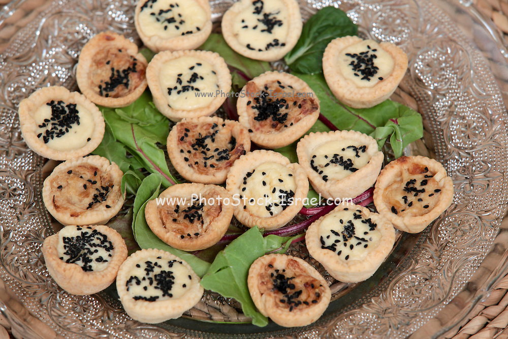 A plate of savoury tartelettes (small tarts with various savoury fillings)
