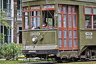 New Orleans,  April 4, 2020,  Streetcar operator  wearing a mask  on St. Charles Ave as the Coronavirus continues to spread globaly.