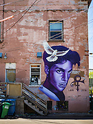"29 APRIL 2016 - MINNEAPOLIS, MINNESOTA:  Minneapolis artist Rock ""Cyfi"" Martinez painted this mural of Prince on a building at 26th Street and Hennepin Ave in Minneapolis. Music icon and legend Prince was from Minneapolis and his commercial empire was based in the Minneapolis suburb of Chanhassen.      PHOTO BY JACK KURTZ"