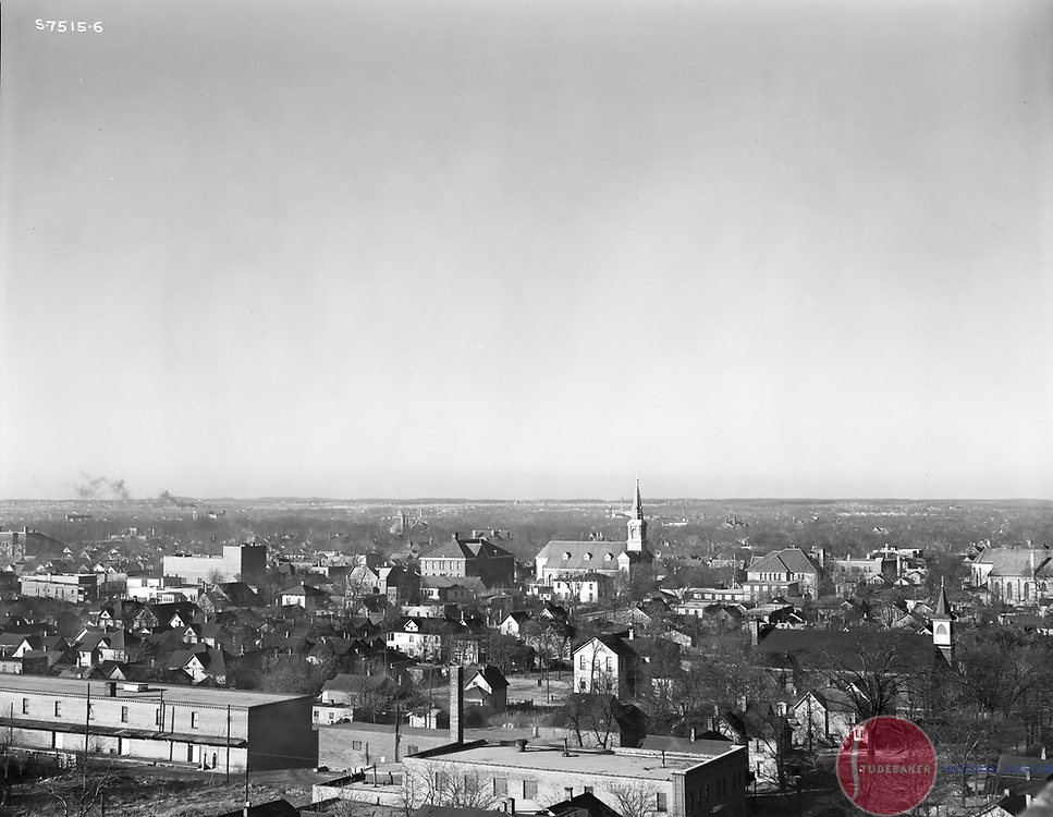 This 1941 image faces northwest and was taken from the roof of Studebaker building #84. St. Hedwig's church steeple is visible.