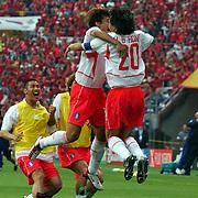 Republic of Korea's Myungt Bo HOng celebrates scoring the winning penalty with Chun Soo Lee