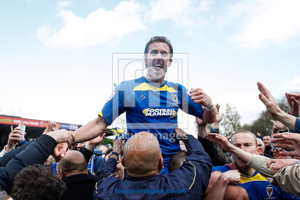 Picture by Andrew Tobin/Focus Images Ltd +44 7710 761829.27/04/2013. Jack Midson of AFC Wimbledon celebrates after winning 2-1 and staying up during the npower League 2 match at the Cherry Red Records Stadium, Kingston.