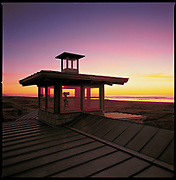 A beach house honors the magic of the sunset. (Benjamin Benschneider / The Seattle Times, 2003)