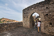 Tourists walk in the village of Savoca, Sicily, Italy. The town was the location for the scenes set in Corleone of Francis Ford Coppola's The Godfather. Bar Vitelli in Savoca, which is still a functioning establishment, was featured in the motion picture as the place where Michael Corleone asked Apollonia's father to meet his daughter.