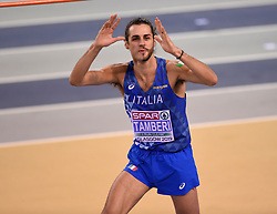 Italy's Gianmarco Tamberi who has shaved half his beard off reacts to the crowd after a jump in the High Jump competition during day two of the European Indoor Athletics Championships at the Emirates Arena, Glasgow.