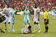 Manchester United Midfielder Paul Pogba argues with Iniesta and Manchester United Forward Romelu Lukaku looks on after a tackle on Manchester United Forward Marcus Rashford during the International Champions Cup match between Barcelona and Manchester United at FedEx Field, Landover, United States on 26 July 2017.