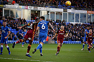 Peterborough United's Jamie Walker (6) and Bradford City defender Connor Wood (23)  trying to get on the  end of this cross during the EFL Sky Bet League 1 match between Peterborough United and Bradford City at The Abax Stadium, Peterborough, England on 17 November 2018.