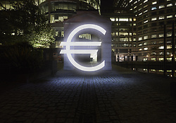 Jan. 14, 2015 - Glowing euro symbol in city street at night, London, UK (Credit Image: © Image Source/Image Source/ZUMAPRESS.com)