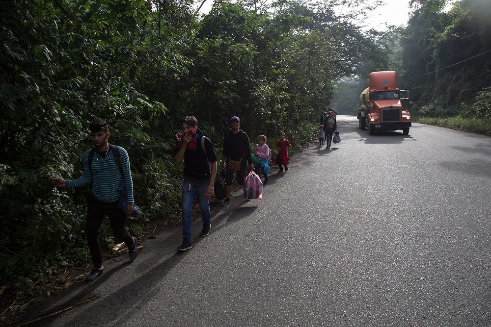 Honduran migrants in a migrant caravan walked long distances early in the morning on their way to the border with Guatemala.