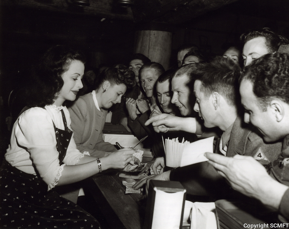 1943 Hedy Lamar and Irene Dunne sign autographs at the Hollywood Canteen