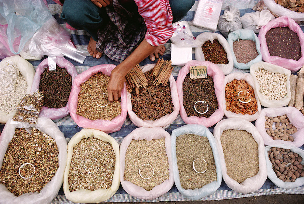 Spices sold by a vendor in the street market in Chiang Mai, Thailand. Material World Project.