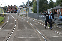 23 September 2017 Manchester : Premier League Football : Manchester City v Crystal Palace:  City fans walking to the Etihad Stadium by crossing the tram track.<br /> Photo: Mark Leech