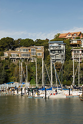 Sailboats and houses, City of Tiburon on San Francisco Bay, CA, California.  Appealing community on Marin side with breakfast places, sailboats, outdoor dining, houses with scenic views, views of the Golden Gate, cormorant birdlife, public sculptures, a railroad museum, boutique art shops, and an historic China Cabin building from an ex-ship..Photo camari261-70312..Photo copyright Lee Foster, www.fostertravel.com, 510-549-2202, lee@fostertravel.com.