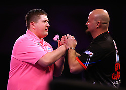 Keegan Brown (left) shakes hands with Karel Sedlacek at the end of the match during day three of the William Hill World Darts Championships at Alexandra Palace, London.