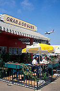 Airplane landing at Lindburg Field, most+dangerous approach route in US. San Diego, CALIFORNIA