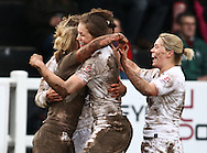 29 Feb 2010 Esher, Surrey: Claire Allan of England (L) is congratulated by her team mates after scoring a try during the Women's Six Nations game between England and Ireland at Esher Rugby Club (photo by Andrew Tobin/SLIK images)