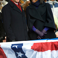 Vice President-elect Biden shares a laugh with Michele Obama during President-elect Obama's speech at their pre-inauguration rally in Wilmington, Delaware, where a crowd of thousands braved sub-zero temperatures to lend their support.  Obama and Biden along with their families traveled by train on a Whistle Stop Tour, opening Inauguration celebrations with rallies in Philadelphia, Wilmington, and Baltimore before their final arrival in Washington, D.C.  The inauguration takes place on January 20, 2009, swearing Obama in as the 44th President of the United States of America.¬?