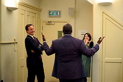 Leader of the Conservative Party David Cameron listening to Conservative candidate Shaun Bailey backstage at a  Cameron Direct in Hammersmith, Tuesday January 5, 2010. Photo By Andrew Parsons / i-Images.