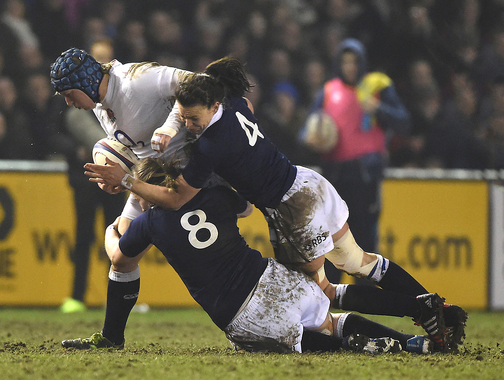 England's Rochelle Clark is tackled by Scotland's Jade Konkel and Deborah McCormack<br /> <br /> Photographer Dave Howarth/CameraSport<br /> <br /> International Womens Rugby Union - 2015 Women's RBS Six Nations - England Women v Scotland Women - Friday 13th March 2015 - The Northern Echo Arena - Darlington<br /> <br /> © CameraSport - 43 Linden Ave. Countesthorpe. Leicester. England. LE8 5PG - Tel: +44 (0) 116 277 4147 - admin@camerasport.com - www.camerasport.com