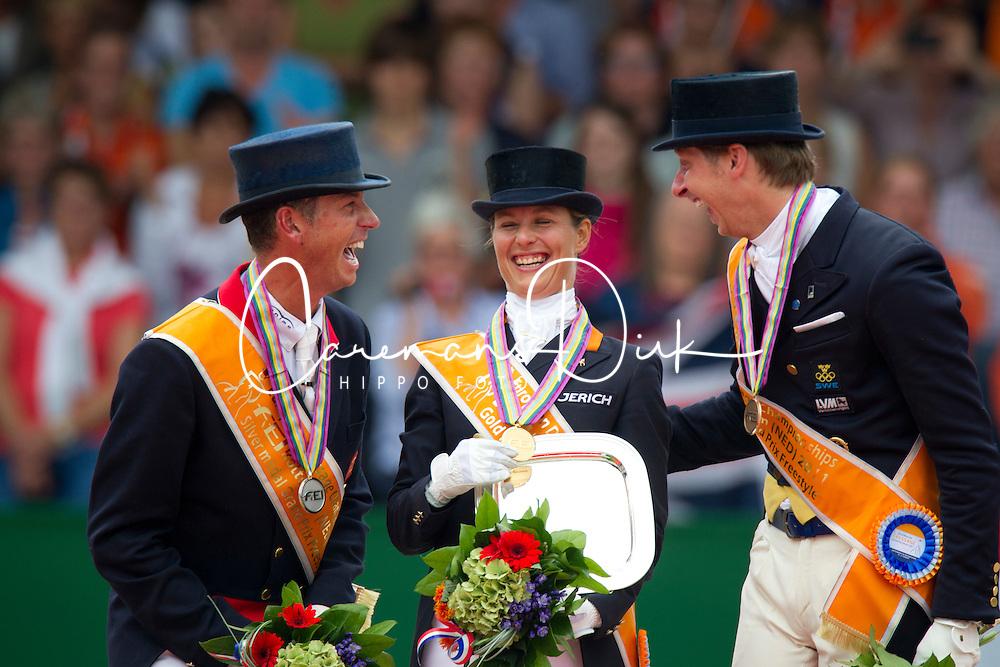 Podium Kür to Music <br /> 1. Adelinde Cornelissen (NED)<br /> 2. Carl Hester (GBR)<br /> 3. Patrick Kittel (SWE)<br /> European Championships Dressage - Rotterdam 2011<br /> © Dirk Caremans