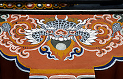 Representation of a dragon painted in traditional Bhutanese style at the top of a concrete column in a new building. This emulates the tradition of painting timbers in traditional wood-built houses.  The dragon is the Bhutanese national symbol, Druk, the thunder dragon. Paro, Druk Yul, Kingdom of Bhutan. 10 November 2007.