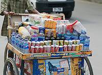 A street vendor sells a variety of drinks and snacks from a pushcart in Dili, Timor-Leste (East Timor)