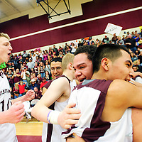 030213  Adron Gardner/Independent<br /> <br /> The Ramah Mustangs collect as district 1-2A champions in front of a capacity crowd after beating the Navajo Pine Warriors 65-51 in Ramah Saturday.