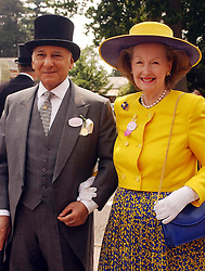 Countess Raine Spencer and a male companion, arrive at Ascot for the first day of the Royal Ascot. The Queen was heading the field at the start of a highlight in the royal calendar and social season.  *  It mixes top horseracing with extravagant hats, Pimms, champagne, smoked salmon, strawberries and cream, and the unreliable English summer.