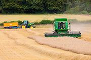 Combine harvester at work in wheat field near Shipton-under-Wychwood