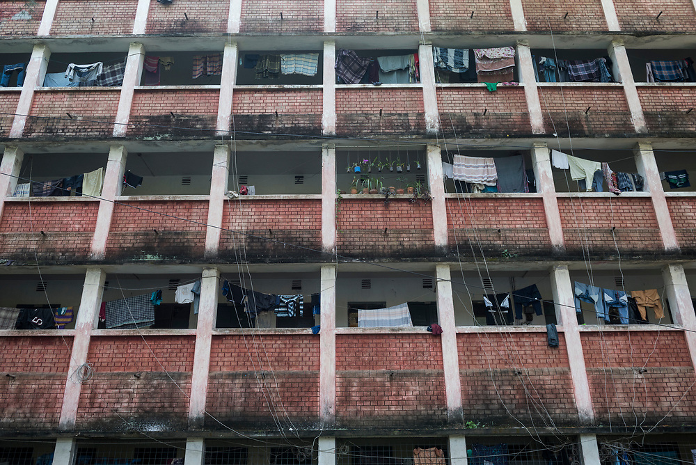 View of laundry drying on clotheslines at a dormitory at the University of Dhaka in Bangladesh. Plants and electric lines are also visible. (2017)