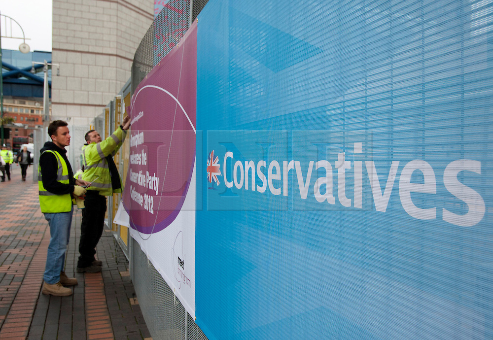 © Licensed to London News Pictures. 05/10/2012.ICC, Birmingham. Preparations are underway to welcome the Conservative Party Conference to Birmingham. Pictured, posters are fixed to the security fences on Broad Street, Birmingham. Photo credit : Dave Warren/LNP
