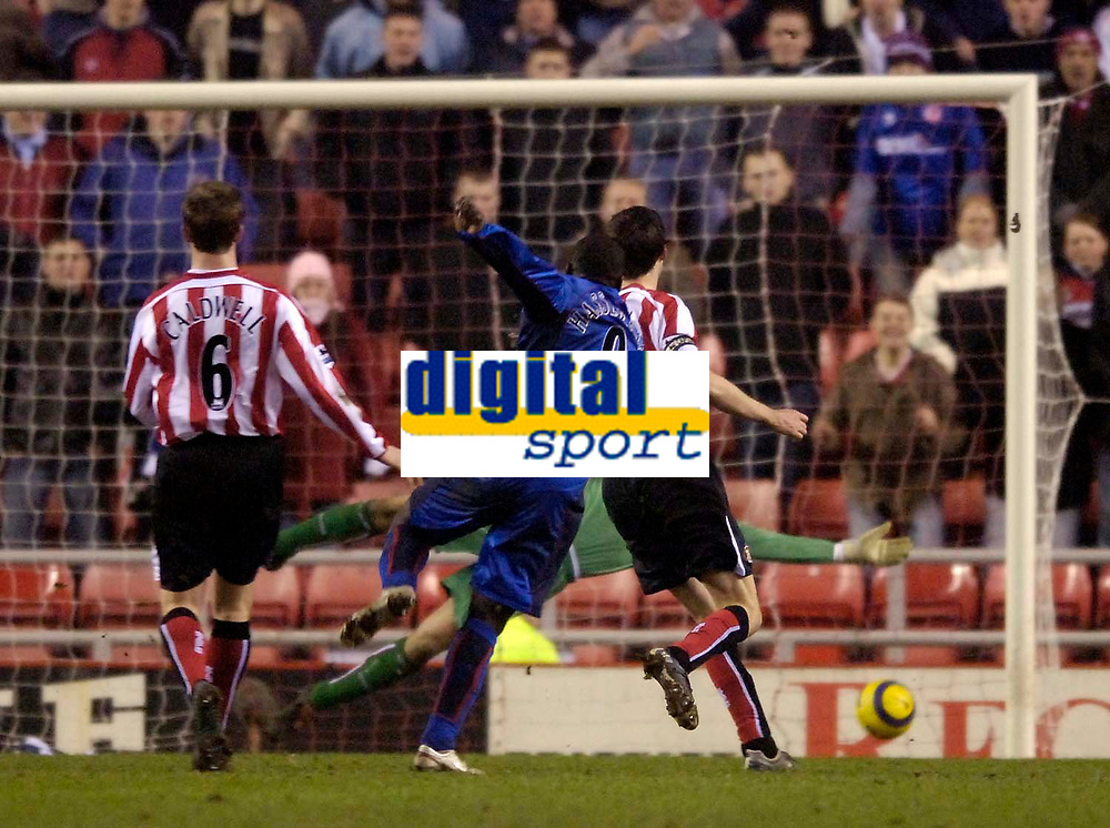 Photo: Jed Wee.<br /> Sunderland v Middlesbrough. Barclays Premiership. 31/01/2006.<br /> <br /> Middlesbrough's Jimmy Floyd Hasselbaink (C) strikes the ball past the dive of Sunderland goalkeeper Kelvin Davies to score their third goal.