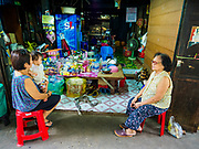 07 JUNE 2017 - BANGKOK, THAILAND:    A woman who owns a small convenience stand (right) in Pom Mahakan visits with a neighbor. Bangkok city officials are expected to tear the structure down in coming weeks. The final evictions of the remaining families in Pom Mahakan, a slum community in a 19th century fort in Bangkok, have started. City officials are moving the residents out of the fort. NGOs and historic preservation organizations protested the city's action but city officials did not relent and started evicting the remaining families in early March.         PHOTO BY JACK KURTZ