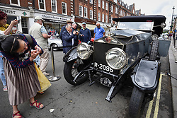 © Licensed to London News Pictures. 17/06/2018. LONDON, UK. Visitors view a 1914 Rolls Royce Silver Ghost at the 6th Annual Classic and Supercar Pageant held at St John's Wood High Street.  Traditionally taking place on Fathers' Day, the show brings together an eclectic mix of exotic and popular vehicles attracting visitors young and old and raises funds for the local charity, The St John's Hospice.  Photo credit: Stephen Chung/LNP